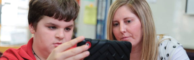 A teacher and student working with an ipad