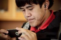 Student using headphones and digital device