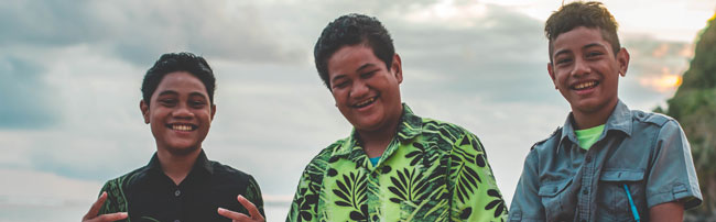 Three smiling boys from Samoa