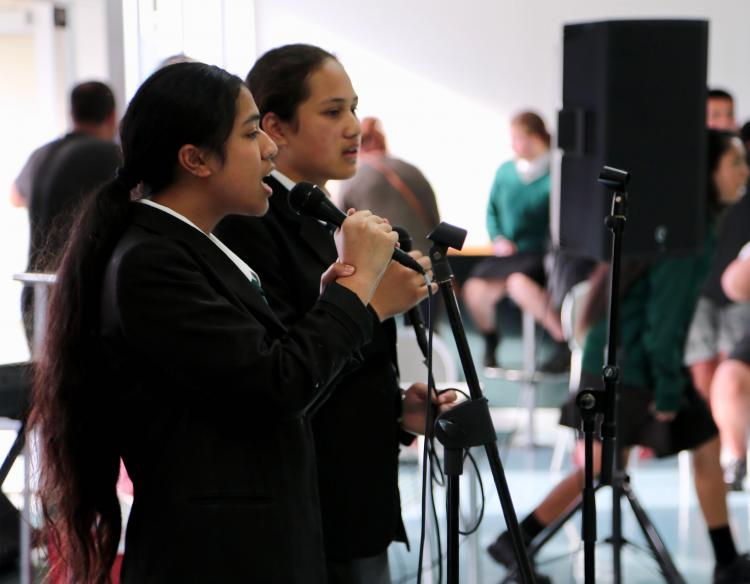 Taita college music students perform pieces in front of parents and guests