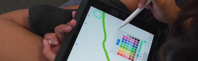 a student drawing on an iPad