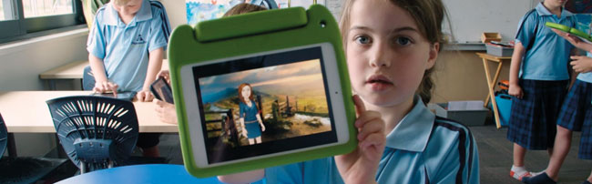 Student displaying a languge learning app on an ipad