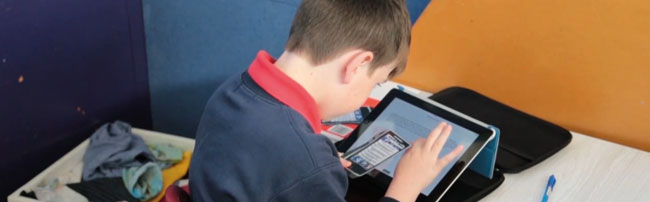 a child using a tablet, universal design for learning