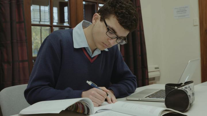 Student working at computer.