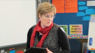 Teacher, Julia Hinman holding an iPad