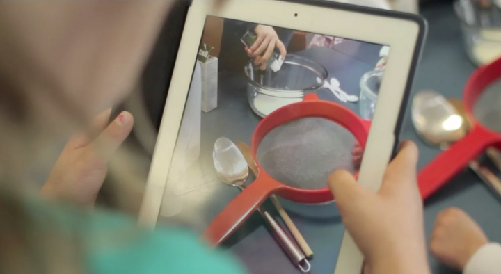 Science experiment with milk being recorded on iPad