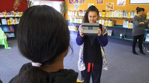 Students filming on tablet